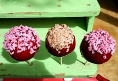 Sweet apples with candy and nuts Stock Image