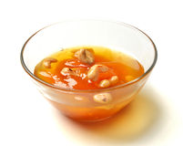 Sweet apricot jam in the transparent glass bowl with cashew nuts Royalty Free Stock Image