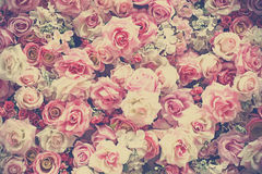 Sweet artificial roses background Stock Image