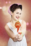 Sweet as sugar lollipop pinup woman offering candy Stock Photography