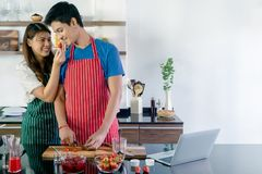 Sweet asian couple preparing healthy drink stock images