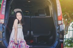 Sweet Asian happy Girl relax on car. After long trip stock image