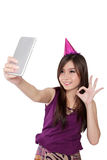 Sweet Asian party girl taking selfie, isolated on white Royalty Free Stock Photo