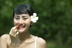 Sweet Asian woman Eating Strawberry Stock Photography