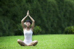 Sweet Asian Woman meditating outdoor Stock Image