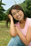 Sweet Attractive Asian / Latino Teenage Girl. Beautiful attractive young Asian / Latino teenage girl smiling happily Stock Photos