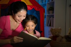 Sweet attractive little girl reading story book Royalty Free Stock Images