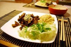 Sweet aubergine with garlic v2. Sweet aubergine with garlic, rice and salad Stock Photos