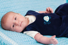 Sweet baby on the bed Royalty Free Stock Image