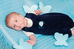 Sweet baby on the bed Stock Image