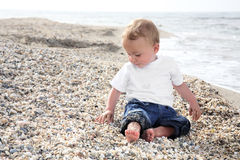 Sweet baby boy on the beach Stock Image