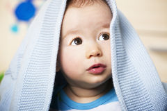 Sweet baby boy with blue blanket. Royalty Free Stock Images