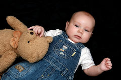Sweet baby boy with cuddly toy. Portrait of three months old sweet baby boy with cuddly toy Royalty Free Stock Photos