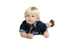 Sweet baby boy laying on the floor, isolated Stock Photography