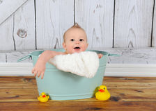 Sweet baby boy playing in washtub Royalty Free Stock Photos