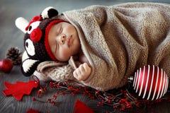 Sweet baby boy sleeping in Christmas eve Stock Image