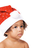 Sweet baby in Christmas hat Royalty Free Stock Photo