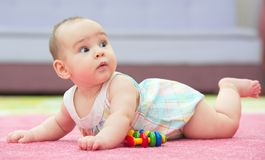 Sweet Baby Crawling And Playing With Toys. On Carpet Stock Photography