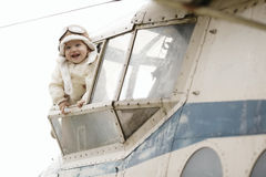 Sweet baby dreaming of being pilot Stock Image