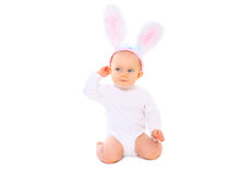 Sweet baby in easter bunny ears on white background Stock Photo