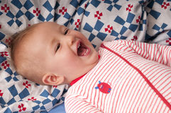 Sweet baby giggles. In bed stock photos