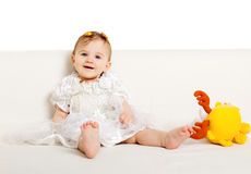 Sweet baby girl. Sitting on the floor Royalty Free Stock Photo