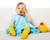 Sweet baby girl. Sitting on the floor Royalty Free Stock Photos