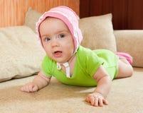 Sweet baby girl. Portrait of cute little baby girl on sofa Stock Image