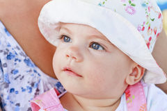 Sweet baby girl with blue eyes. With her mom royalty free stock photos