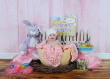 Sweet baby girl in easter egg Royalty Free Stock Photos