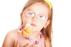 Sweet baby girl eating bread Royalty Free Stock Image