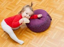 Baby. Eating. Head. Bread. Floor stock photo