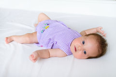 Sweet baby girl in a first summer dress. Adorable sweet baby girl in a first summer dress Royalty Free Stock Photography