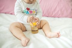 Sweet baby girl holding water bottle at home. Sweet baby girl holding water bottle at home Stock Photo