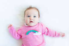 Sweet baby girl in a knitted sweater. Sweet little baby girl in a knitted sweater Stock Images