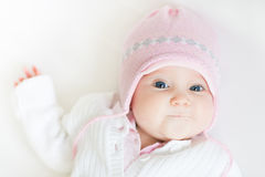 Sweet baby girl in a pink knitted hat Royalty Free Stock Photos
