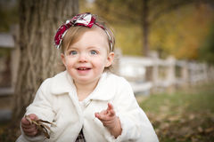 Sweet Baby Girl Playing in Park Royalty Free Stock Photography