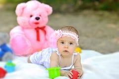 Sweet baby girl playng Stock Image