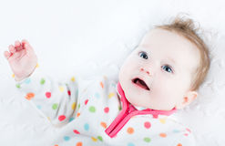 Sweet baby girl in a polka dots sweater. Sweet little baby girl in a polka dots sweater royalty free stock image