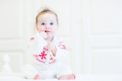 Sweet baby girl in a scandinavian knitted sweater Stock Image