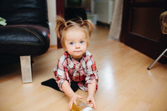 Sweet baby girl sitting on the floor Royalty Free Stock Photography