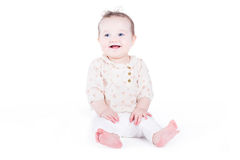 Sweet baby girl sitting and laughing Stock Photos