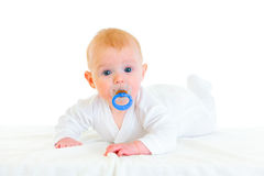 Sweet baby girl with soother laying on diaper Stock Photography