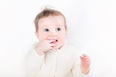 Sweet baby girl sucking on her finger. Isolated on white Stock Photos