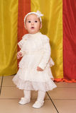 Sweet baby girl in a white dress Royalty Free Stock Photo