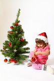Sweet baby in a hat of Santa Claus Stock Image