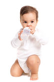 Sweet baby holding bottle and drinking water Stock Photography
