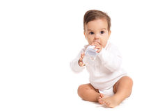 Sweet baby holding bottle and drinking water Royalty Free Stock Photography