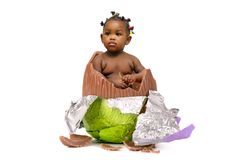 Baby inside an Easter egg. Sweet baby inside an Easter egg isolated in white Stock Photography