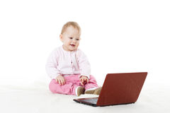 Sweet baby with laptop. Stock Image